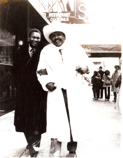 Heavyweight Champion Larry Holmes and Don King in coats and accessories by Anna Nateece